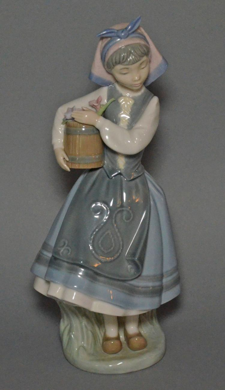Lladro Porcelain Figure Of A Girl Holding A Barrel Of Flower