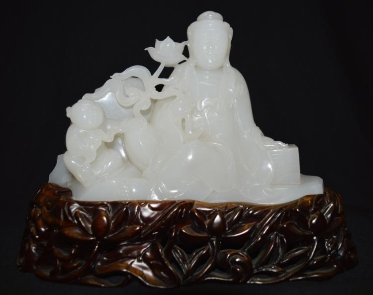 Hetianyu Jade Craving of Guanyin on Wood Stand