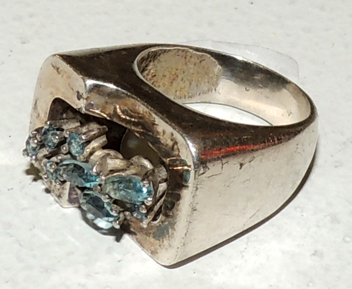 DESIGN RING with blue topaz carving and silver mount.