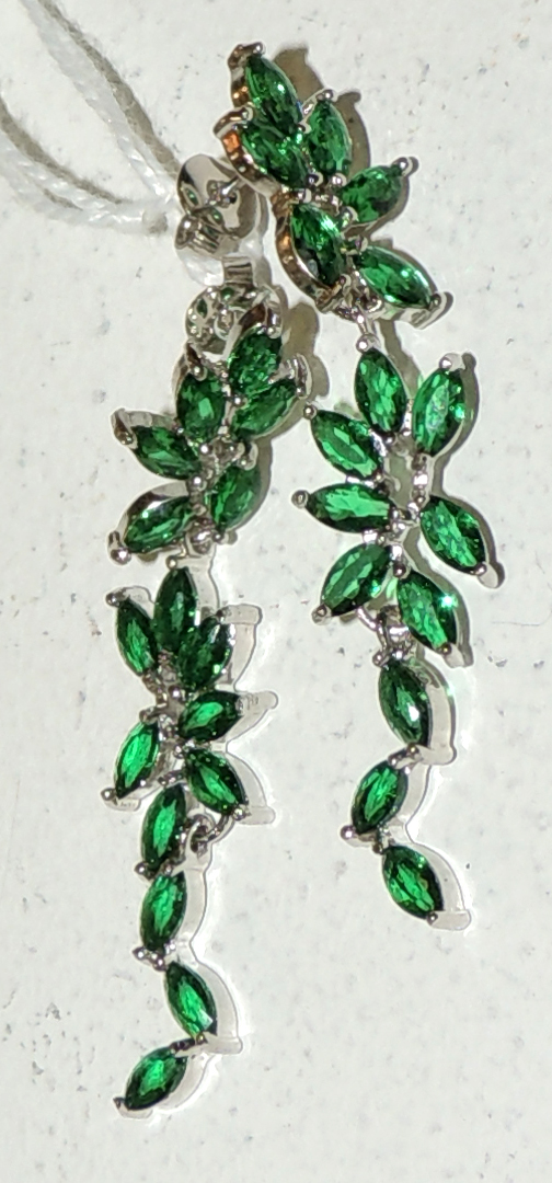 EARRINGS in silver with green colored zircons forming filigree.