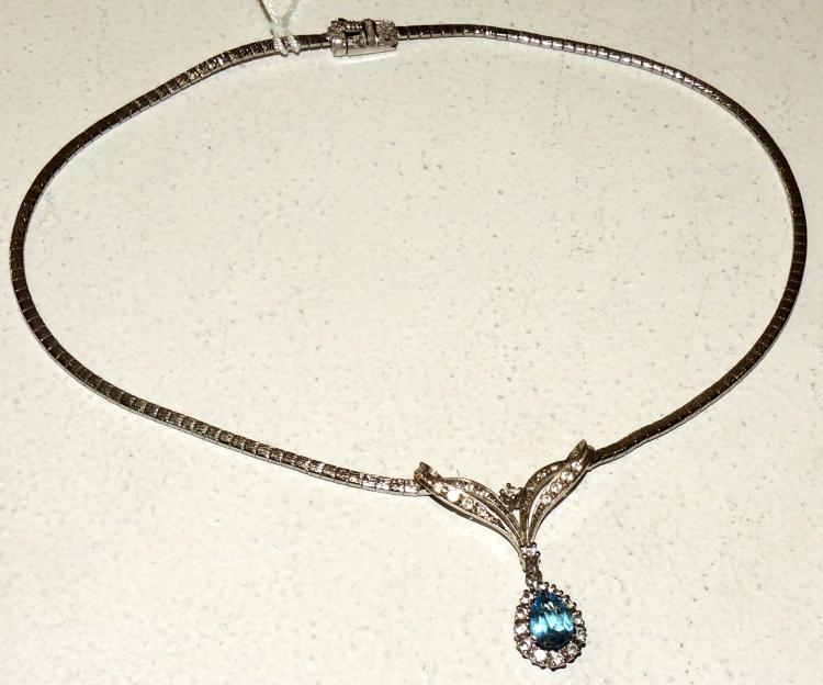 CHOKER WITH BLUE TOPACIO bordered by zircons. Mount as a lacing and chain in silver.