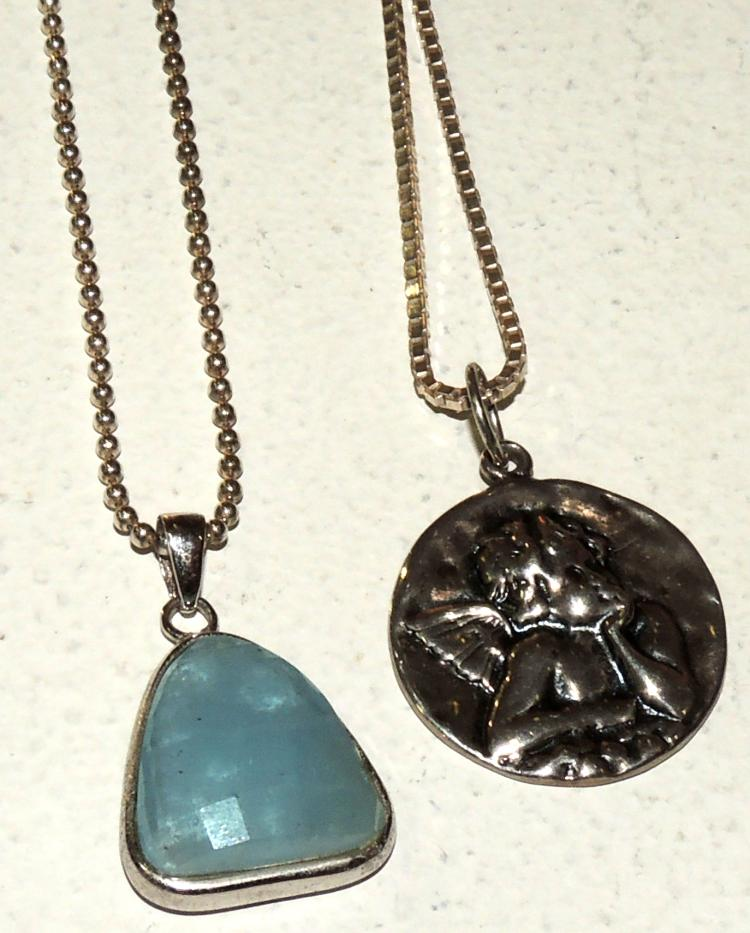 TWO PENDANTS WITH CHAINS in silver.