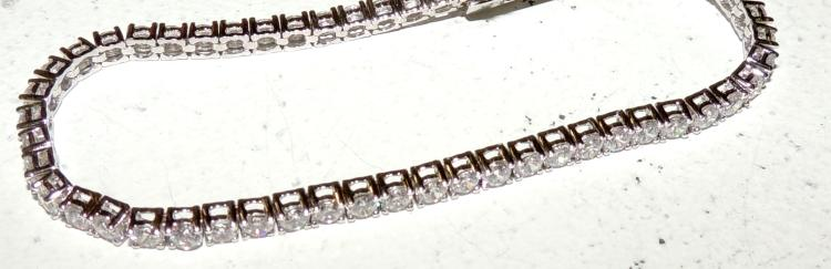 RIVIÉRE BRACELET in rhodium-plated silver and staple-mounted zircons.Tongue and security lock.