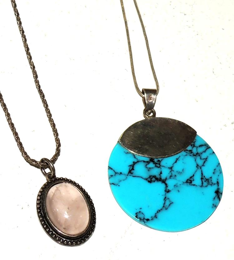 TWO PENDANTS WITH turquoise and rose quartz chains with silver frames and chains.