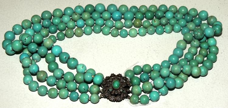 NECKLACE of turquoises forming 4 strips in scale with setting of different inlays.