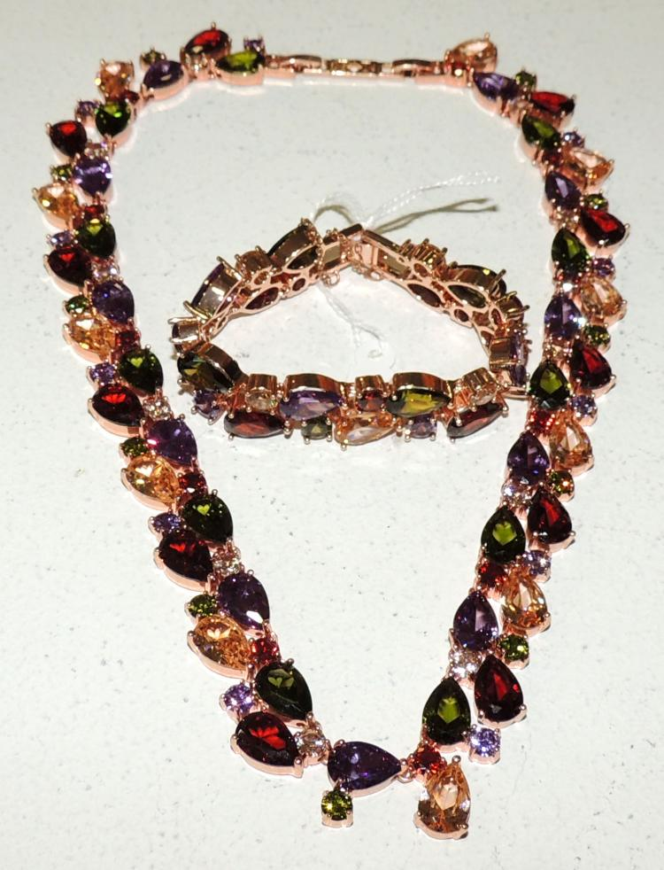 NECKLACE AND BRACELET SET with rose gold bath with colored zircons.
