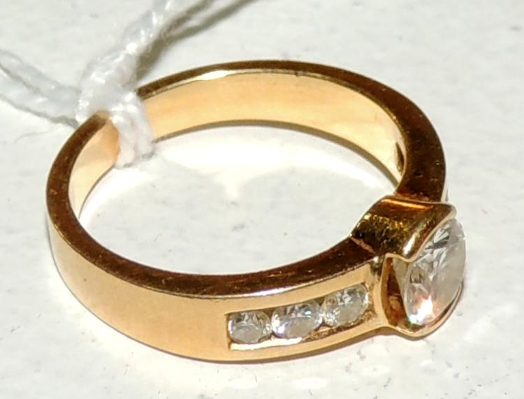 BRILLIANT RING of bright central with three sides.Russian mouthpiece in yellow gold.