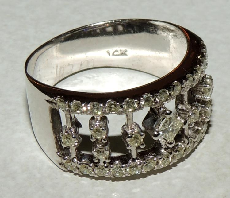 BRILLIANT RING with frame set in white gold.