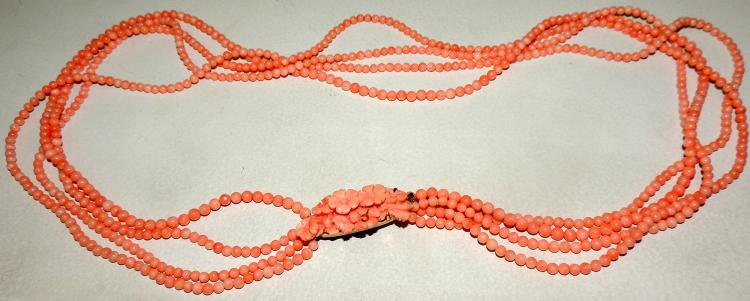 ANGEL LEATHER CORAL NECKLACE consisting of four strips of beads.Brooch forming flowers.Length: 83 cm.
