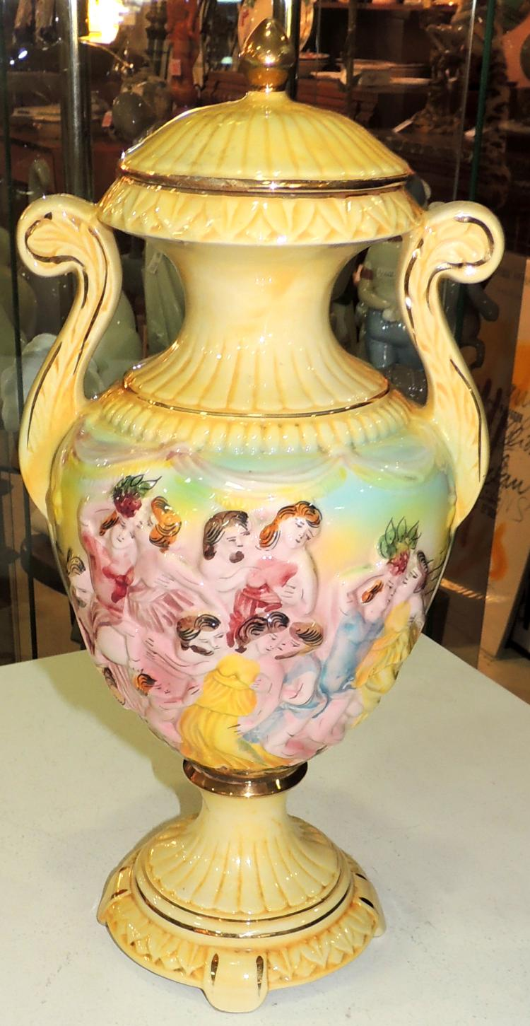 TIBOR in Capodimonte porcelain with classic scene decoration on yellow background. Height: 42 cm