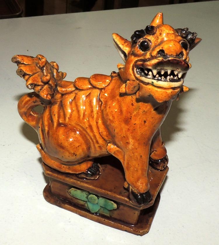 FOO DOG FIGURE in glazed porcelain and enameled brown.Height: 15 cm