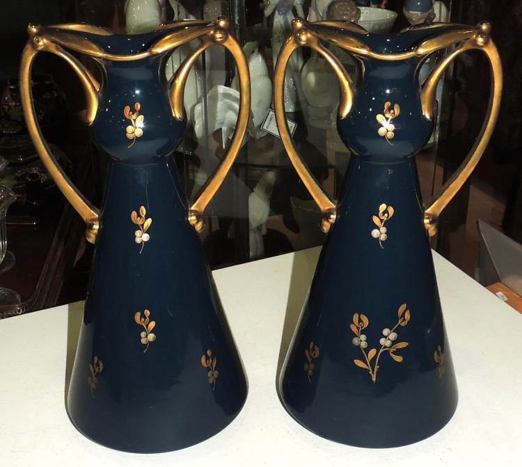 COUPLE OF MODERNIST VASES in enameled porcelain blue color with vegetal decoration in golden tones.Marks in the base.Height: 36 cm