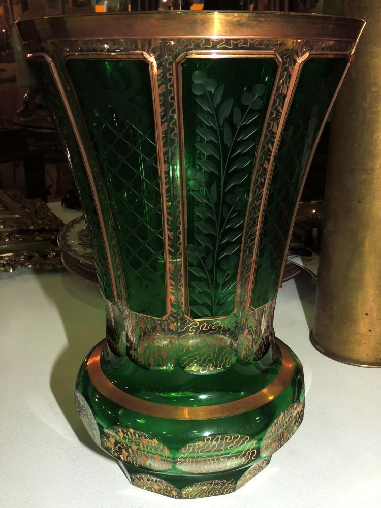 VASE in double crystal of green Bohemia carved and faceted with golden decoration. Height: 23 cm