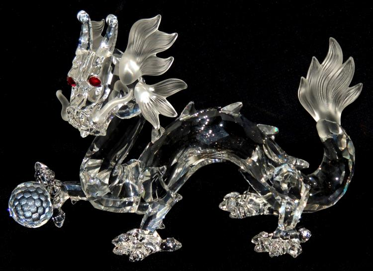 SWAROVSKIFABULOUS CREATURES crystal dragon with certificate and original box.Annual edition 1997. Measurements: 10x14 cm.