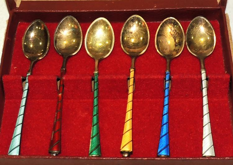 COLLECTION OF SPOONS in golden silver with enamel decoration of different colors in original box.