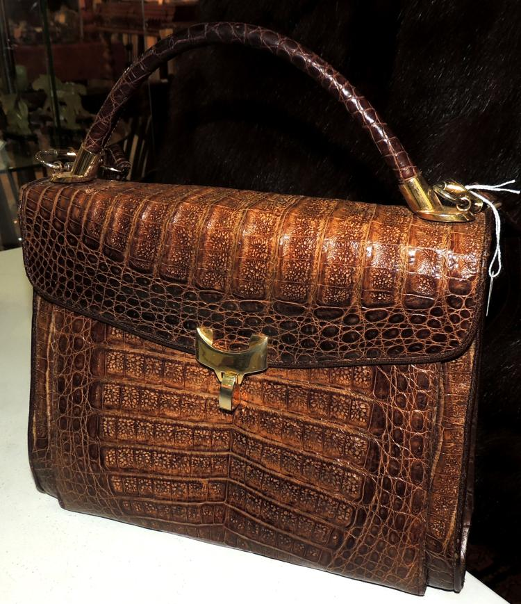 BAG in light brown crocodile skin with a long shoulder strap and a short one.