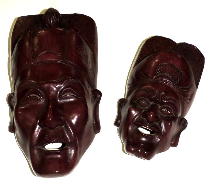 TWO ORIENTAL MASKS in carved rose wood.Long: 31 and 23 cm.