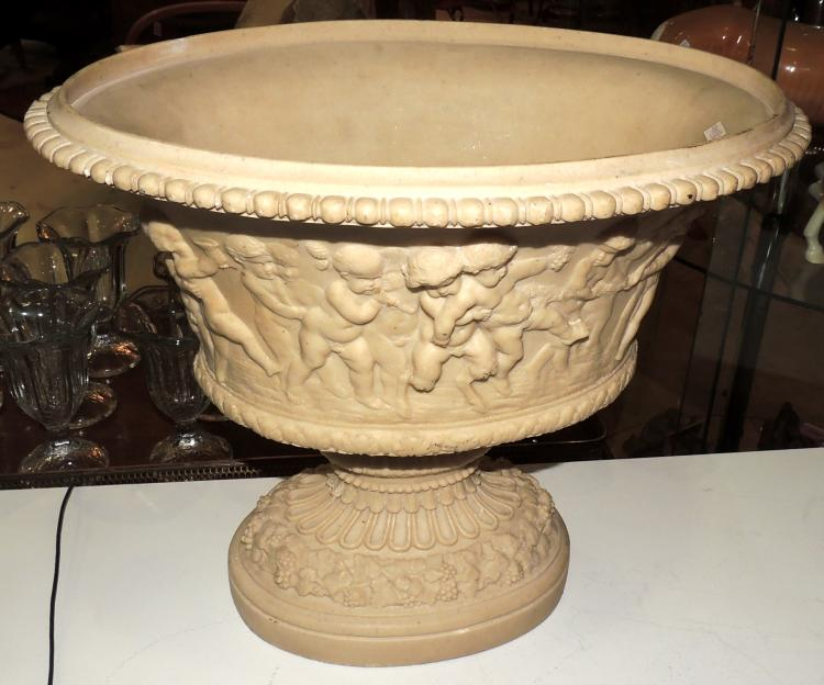 DECORATIVE CUP in marmolina with decoration in relief of cherubs and vines at the base. Measures: 35x42 cm.