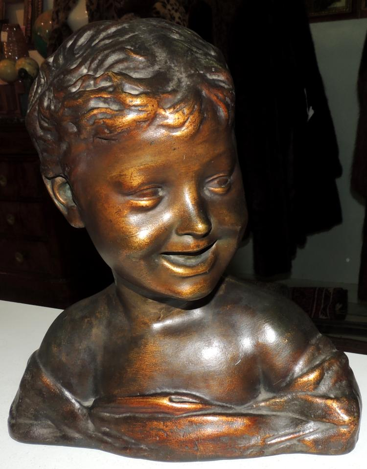 BUST OF CHILD Esteva & Cia in patinated plaster.Height: 31 cm