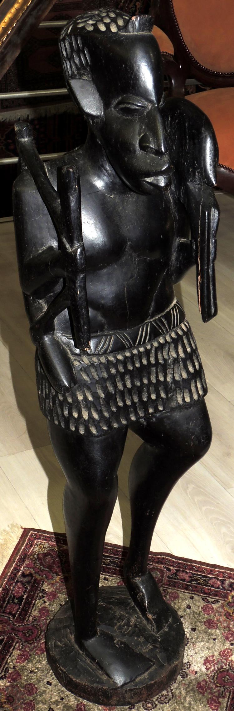 AFRICAN FIGURE in carved ebony wood.Height: 97 cm