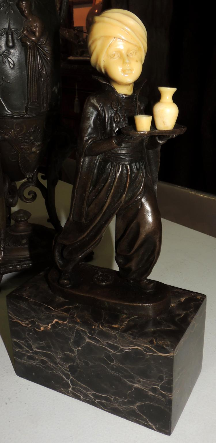 FIGURE OF ARAB CHILD in bronze and paste with marble base.Total height: 28 cm.