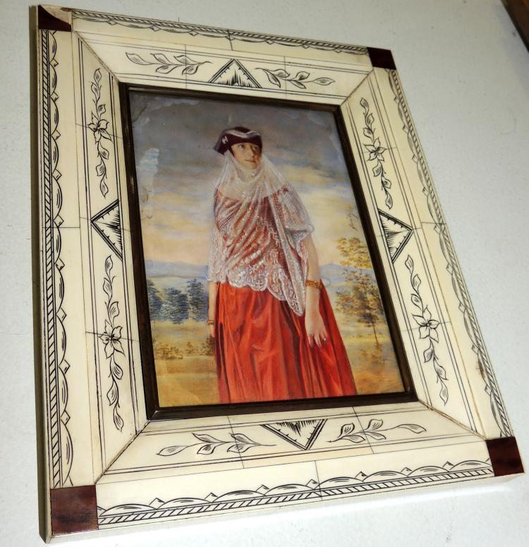 MARCO PORTA PORTRAITS formed by plates of pyrography bone.With lig.afterWith colored lady photography.Measures: 21x17 cm.