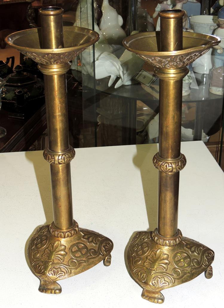 PAIR OF CHURCH CANDELERS in gold metal and decorated with vegetal decoration.Height: 42 cm