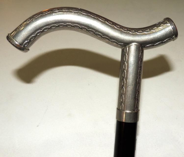 STICK CANE with silver handle.Height: 91 cm