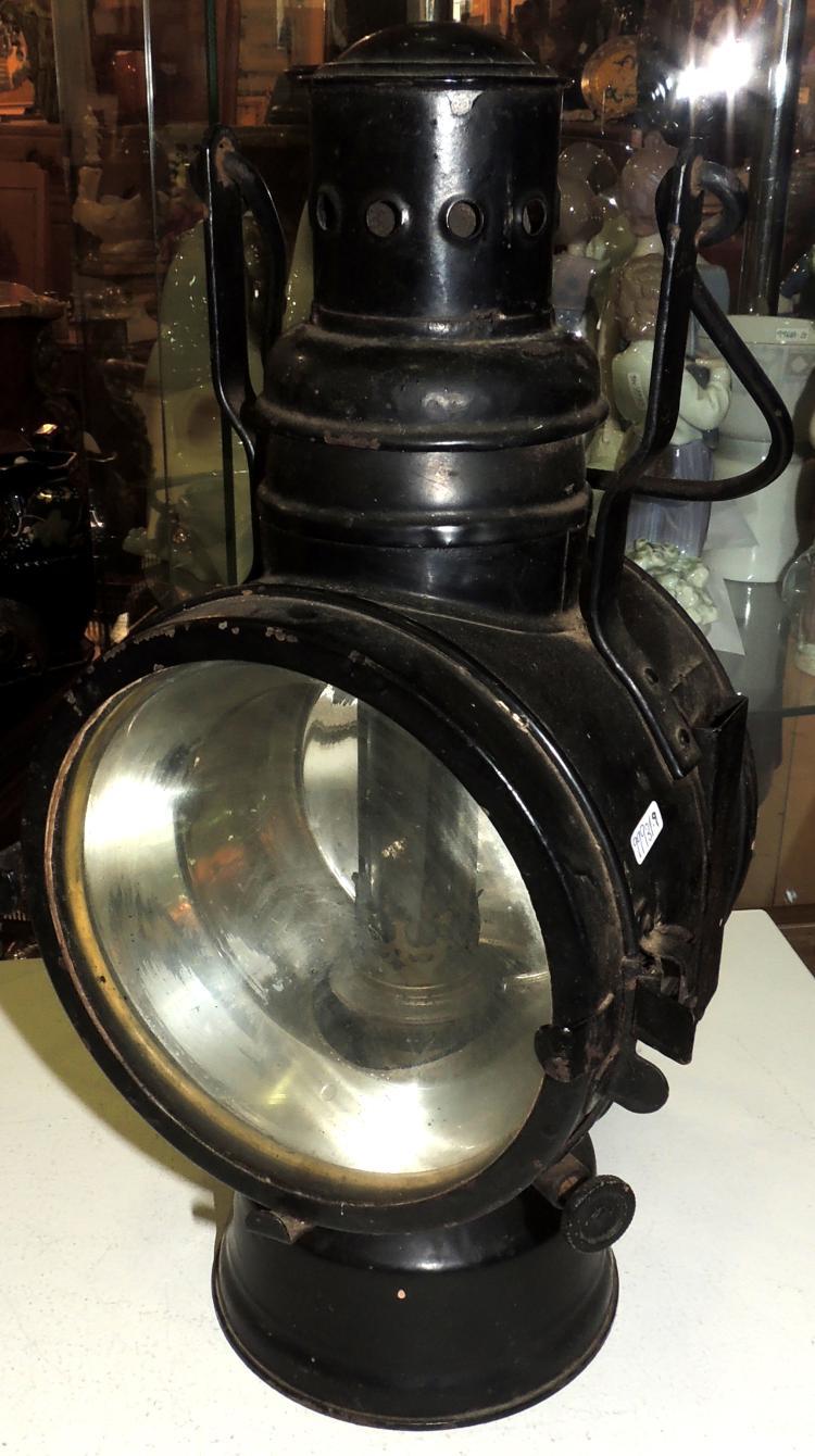 TRAIN LANTERN in black patinated iron.Measures: 39x22x14 cm.