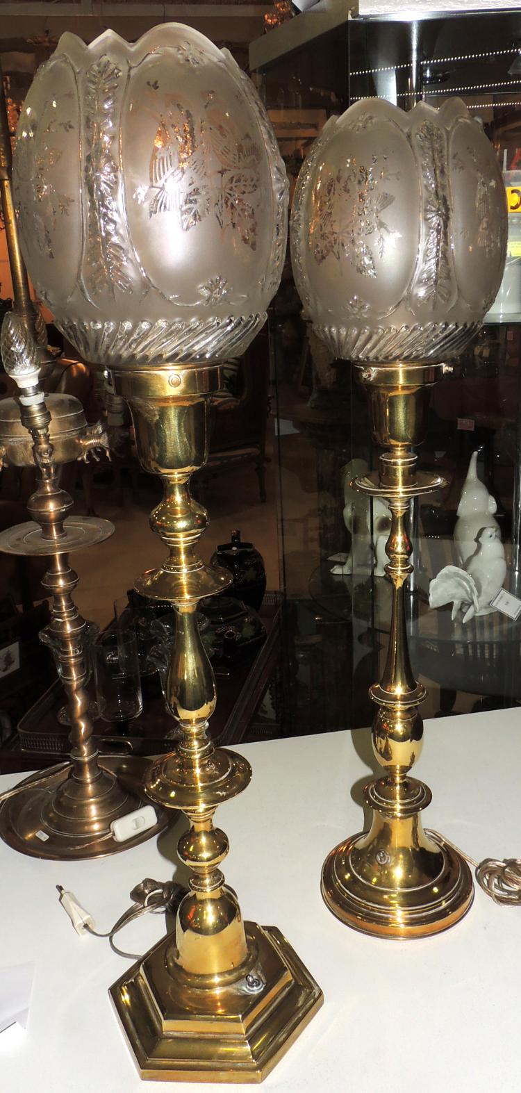 TWO TABLEWARE LAMPS, subsequently electrified in gilded bronze with glazed glass shades engraved with acid and decorated with birds.Heights: 74 and 78 cm.