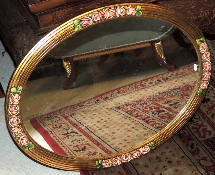 ISABELINO MIRROR in gilded wood with flower decoration.Measures: 66x41 cm.