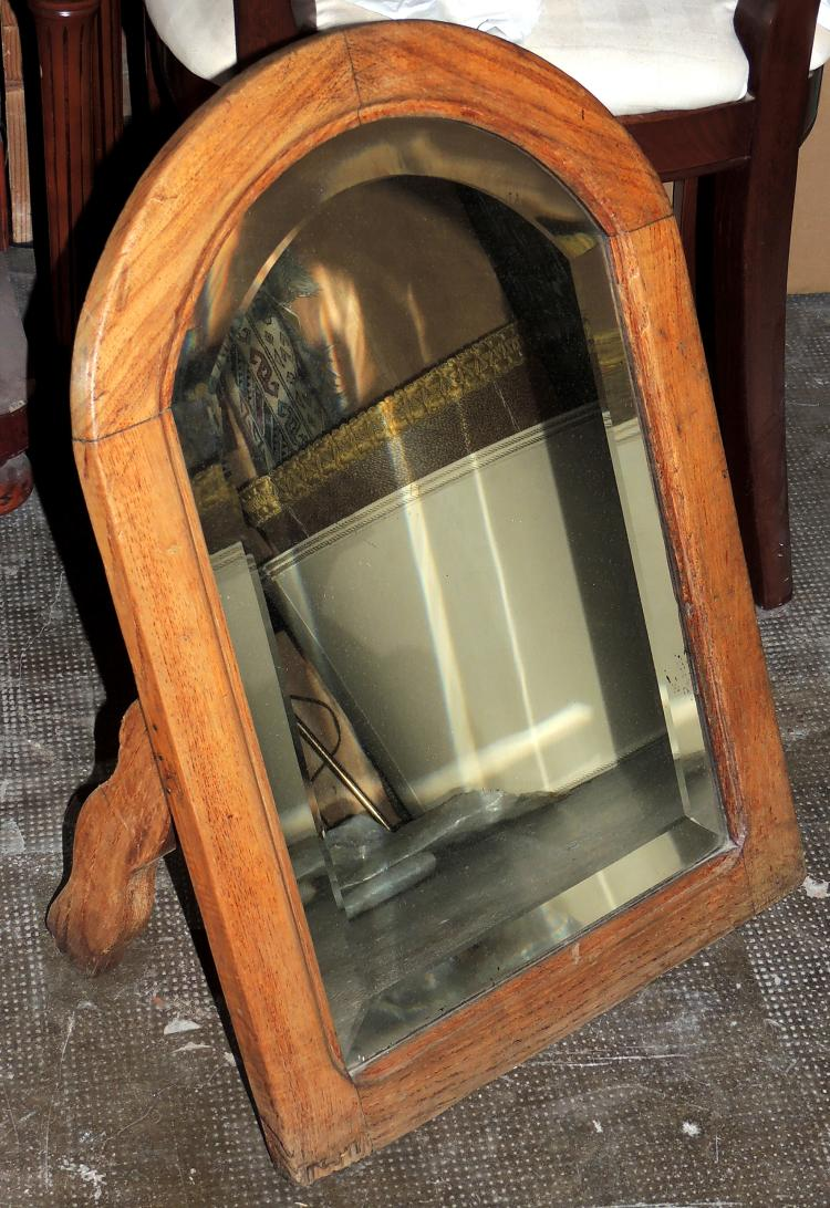 MIRROR in wood of natural color and beveled glass.Measures: 60x41.5 cm.Lig.afterin the wood.