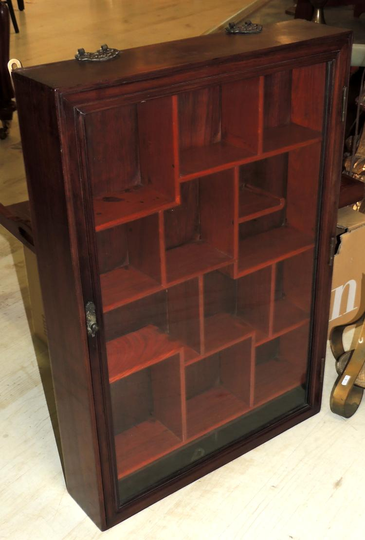 ORIENTAL SHOWCASE in wood with interior made to measure in wood of palisandro with different departments.Measures: 67x47x10 cm.