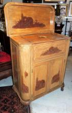 ORIENTAL BAR FURNITURE in carved wood with relief of traditional scenes with pagodas as a handle.Measures: 107x87x48 cm.