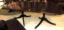 ENGLISH TABLE in wood.Extensible.It supports on two pedestals with grooved legs.Measures: 71x164x112 cm.