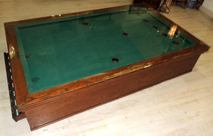 AUXILIARY TABLE as a Russian billiard with glass envelope.Measures: 35x184x114 cm.