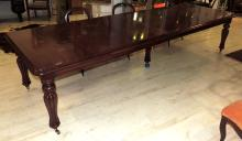 GREAT ENGLISH TABLE in wood with balustraded legs and topped by wheels.Total measures: (With the three lengthens) 75x347x113 cm.