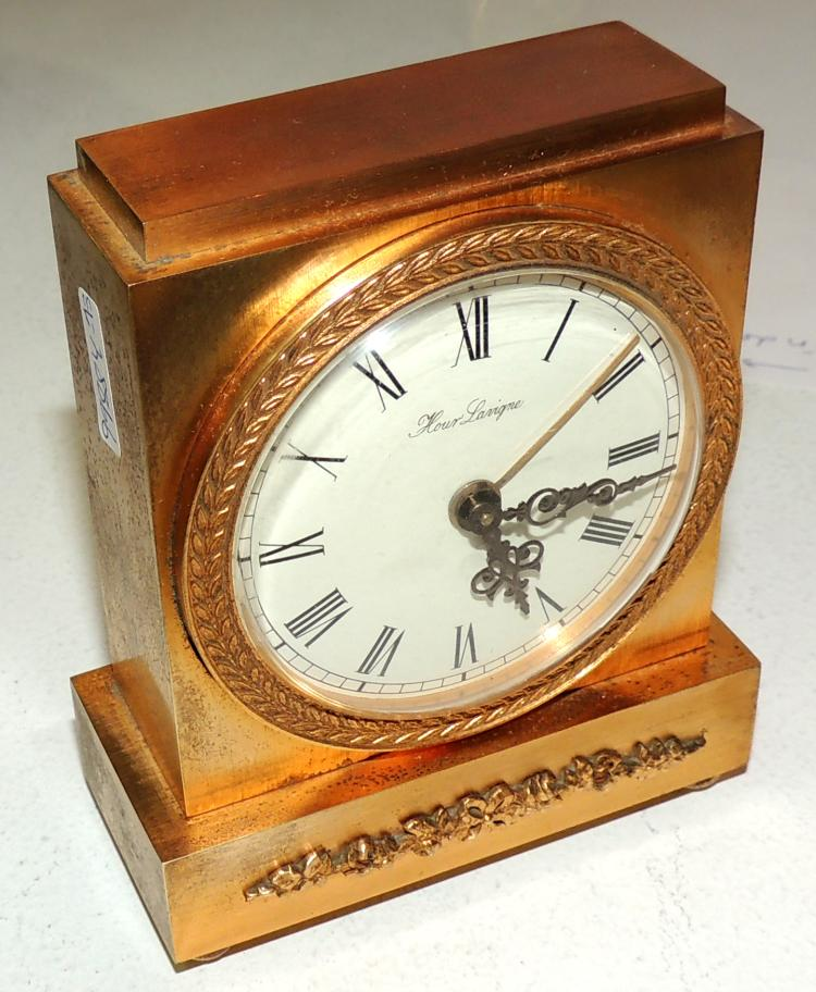 SIXTEEN CLOCK CLOCK Hour Lavigne in gold-plated bronze with garland detail. Measures: 11x8x4 cm.
