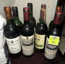 SET OF EIGHT RED WINE BOTTLES