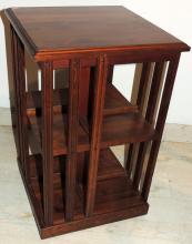 TWO TIER REVONVING BOOKCASE TABLE