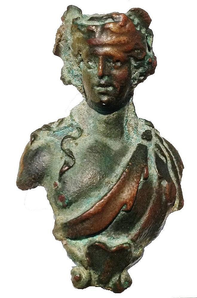 A ROMAN BRONZE BUST OF DIONYSUS 2nd-3rd century CE. 5.6 cm high. With very nice brown and green pati
