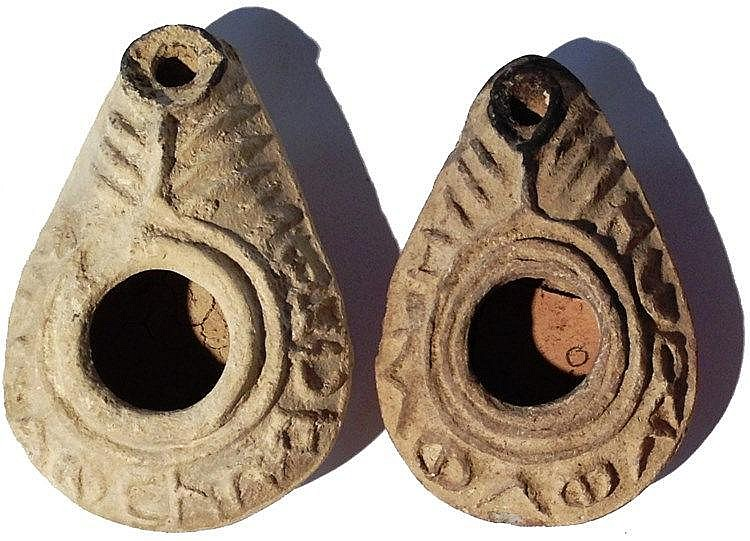 A LOT OF 2 CHRISTIAN TERRACOTTA OIL LAMPS Byzantine Period, 5th-7th century CE. Both with a Gre