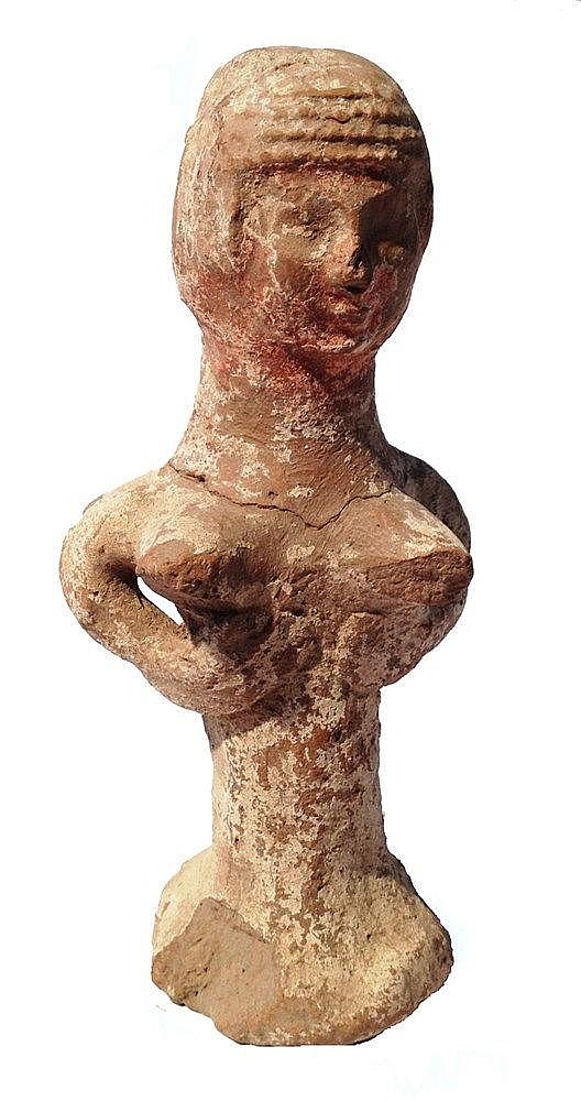 A JUDAHITE CERAMIC PILLAR FIGURINE 8th-7th century BCE. With traces of white-wash and brown paint on