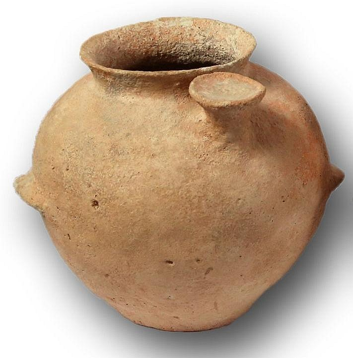 A TERRACOTTA JAR WITH SPOUT Early Bronze Age I, 3100 – 2900 BCE. With three ledge handles. In v