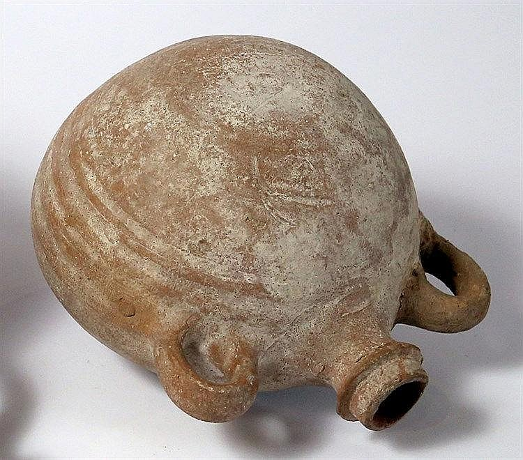 A TERRACOTTA PILGRIM FLASK Byzantine Period, 4th-6th century CE. One handle is restored but in