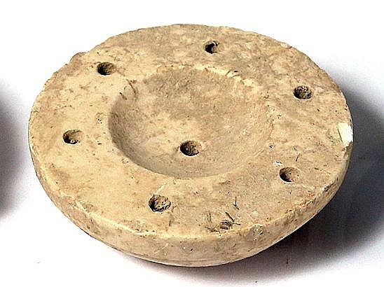 A WHITE-STONE COSMETIC BOWL Iron Age II, 800 – 586 BCE. 8.5 cm in diameter. Decorated with seve
