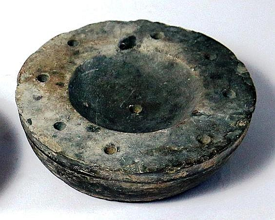 A GRAY-STONE COSMETIC BOWL Iron Age II, 800 – 586 BCE. 8.5 cm in diameter. Decorated with nine