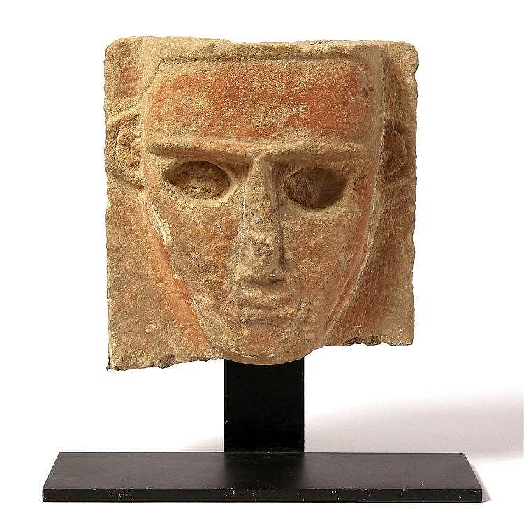 A SOUTH ARABIAN (YEMENITE) SANDSTONE STELE MASK Ca. 2nd-1st century BCE. 19x18 cm. The low