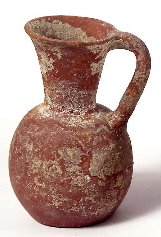 A RED SLIP TERRACOTTA JUG Iron Age II, ca. 8th century BCE. In very good condition. 17.5 cm hig