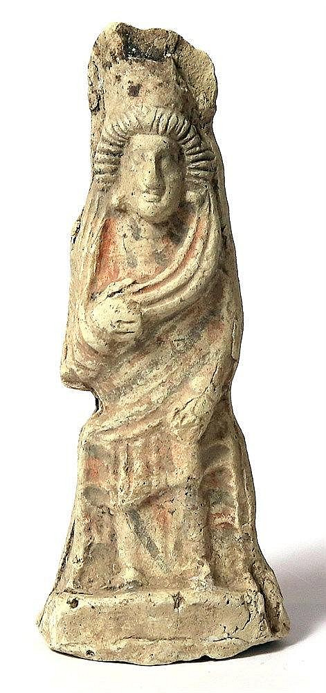 A PARTHIAN TERRACOTTA FIGURINE OF A LADY 2nd century BCE – 3rd century CE. With traces of white, bro